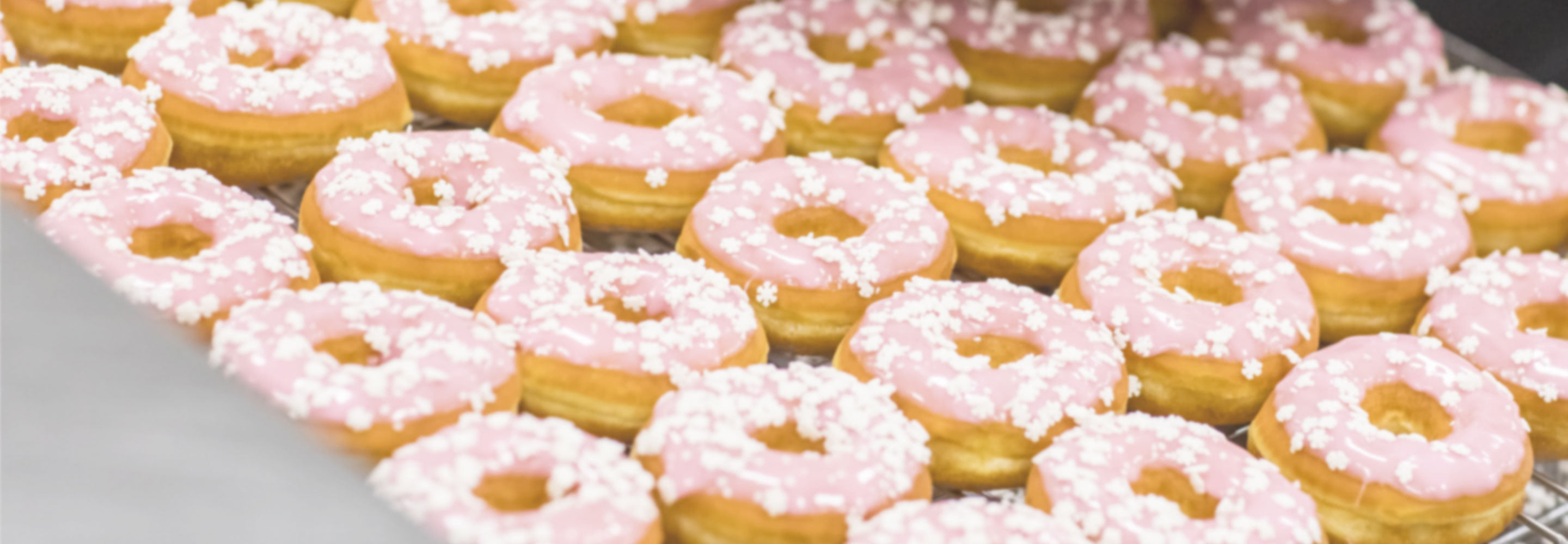 Image of donuts with snowflake sprinkles